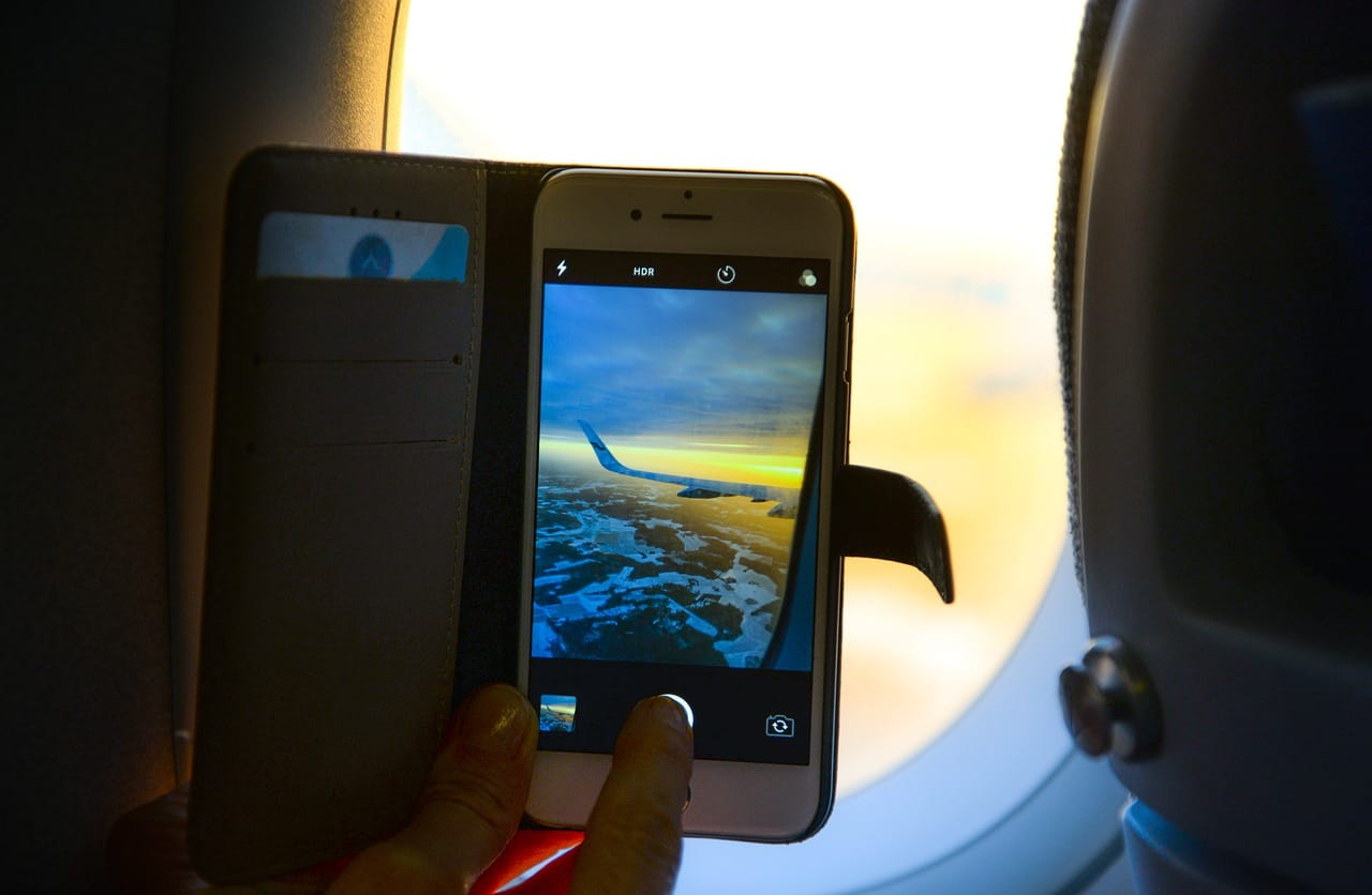 Why do we have to put your phones on airplane mode on a plane